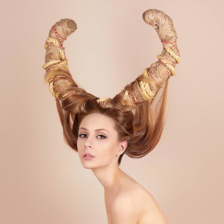 nude blonde: fashion art portrait of sexy beautiful woman with horns. Hairstyle concept girl Stock Photo