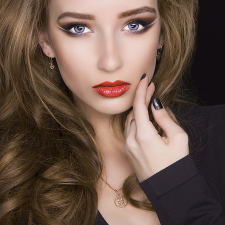 fashion portrait of beautiful young woman with make-up.beauty red lipstick model girl photo
