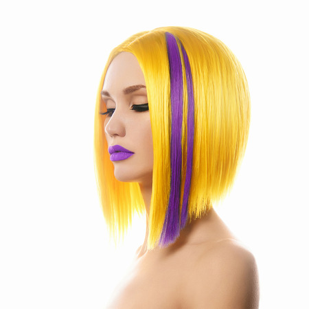 Unusual hairs.Yellow purple Hair. Haircut. Beautiful Girl with Short Hair. Hairstyle. Bob. Fringe. Profile Portrait of Fashion Beauty Woman