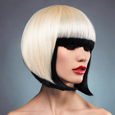 hairstyles: Beautiful woman with unusual bob hairstyle.Red lips model. Sexy girl Stock Photo