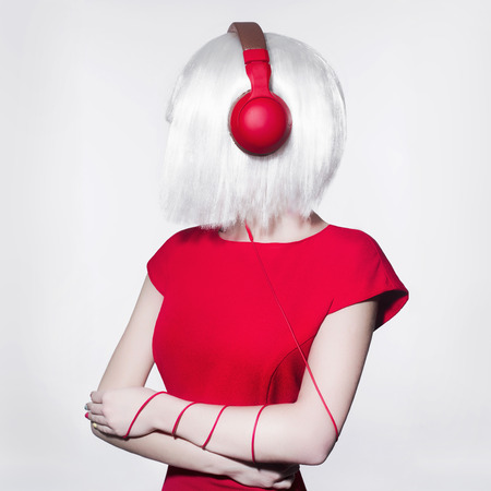 techno Woman listening music on headphones. Fashion portrait of beautiful girl with bob hair.dj