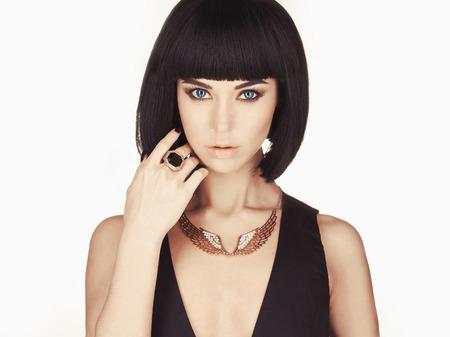 fashion jewelry: Studio fashion photo of beautiful stylish woman. Girl with bob hair
