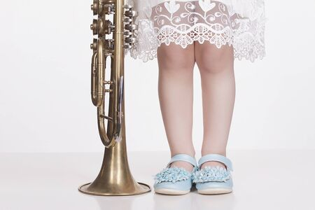 musical child.little girl with trumpet.musical instrument Stok Fotoğraf