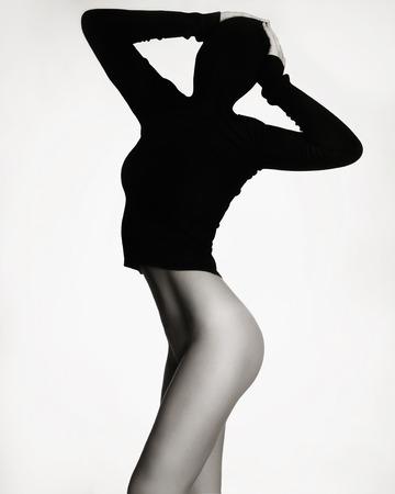mujer sexy desnuda: mujer desnuda sexy en negro turtleneck.unusual foto de moda de la muchacha cuerpo perfecto Foto de archivo