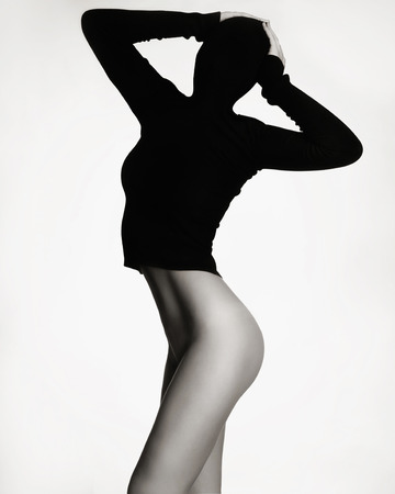 naked black woman: sexy naked woman in black turtleneck.unusual fashion photo of perfect body girl Stock Photo