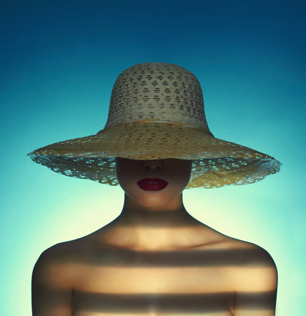 hat nude: fashion portrait of sexy woman in hat.