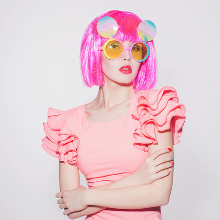 fashion portrait of beauty young woman with pink bob hairstyle.Unusual sunglasses.Beautiful girl.love parade