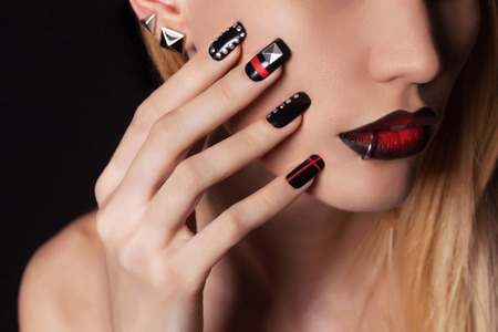 nails: young woman with manicure.Beautiful model with make-up.Nail design