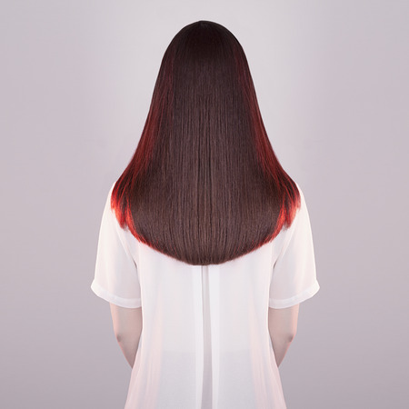 long red hair woman: art fashion portrait of women beautiful healthy long hair.back of brunette girl.red hair of young woman Stock Photo