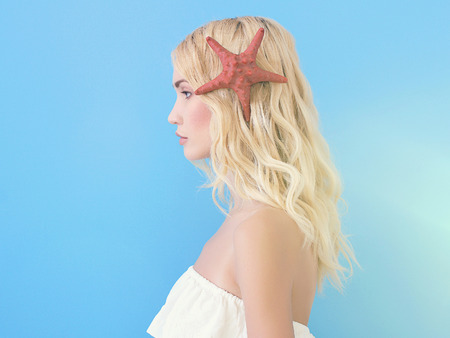 beautiful blond girl with starfish. sea sun summer concept.fantastic nymph woman.fashion art portrait Stok Fotoğraf