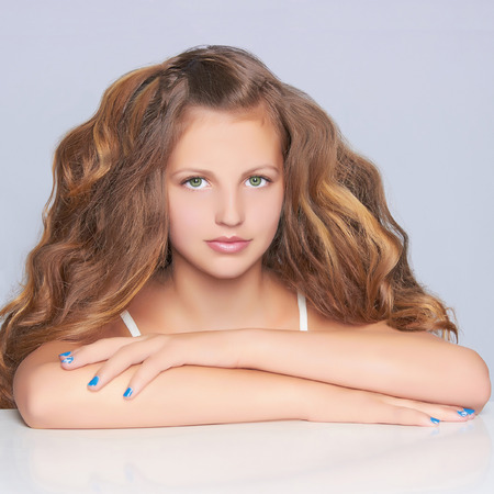 12 13: beautiful teen girl.close-up portrait of teenager girl with long healthy hair