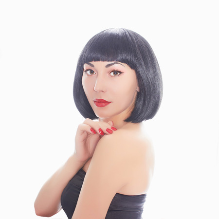 asian style: young woman bob haircut.girl with red lips and red nails.make-up and manicure