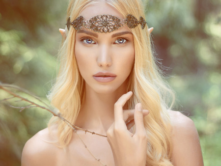 hero: beautiful elf girl. fantasy young woman in woods