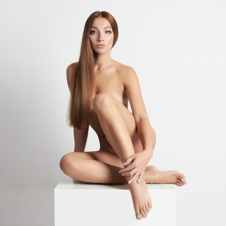 nude woman sitting: nude beautiful young woman. sexy girl with long hair Stock Photo