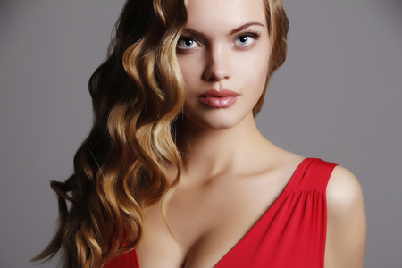 beautiful young woman. Healthy hair girl with make-up.Lady in red Stockfoto