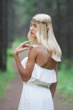 forest wood: elf.beautiful girl. fantasy young woman in woods
