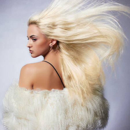 Beautiful blond young woman in fur.winter fashion.Beauty sexy Model Girl with healthy hair. Woman in Luxury Fur coat Stockfoto