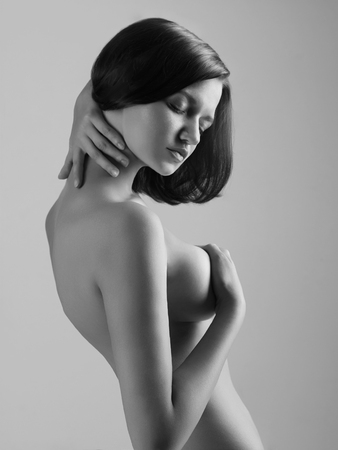 topless brunette: Attractive topless woman.Monochrome portrait of sexy naked girl with big breasts