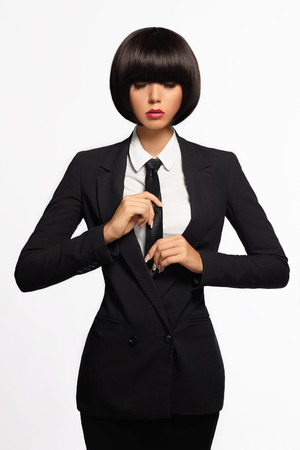 beauty business woman in formal suit and tie. bob haircut.isolated beautiful girl in suit Standard-Bild