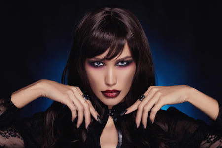 beautiful young vampire woman.black haired sexy halloween girl Stock Photo