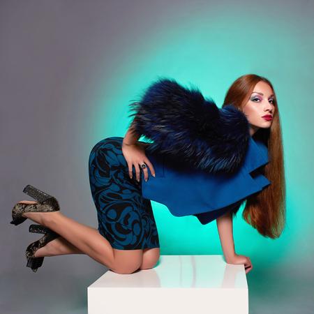 Beautiful young woman in fur.winter fashion.Beauty sexy Model Girl. Woman in Luxury Fur coat Stock Photo