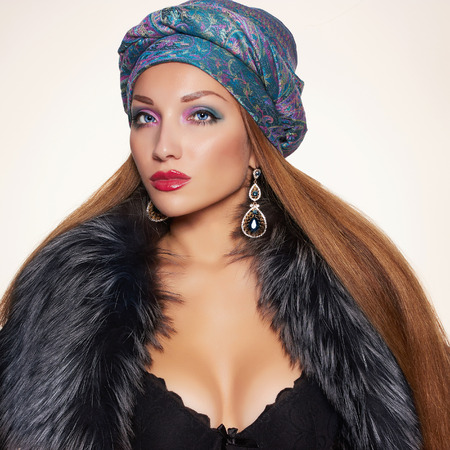 sexy glamour: rich Beautiful woman in fur and arabic turban.winter fashion.Beauty sexy Model Girl in Luxury Fur coat,jewelry and underwear