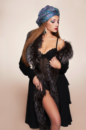 sexy fur: rich Beautiful woman in fur and arabic turban.winter fashion.Beauty sexy Model Girl in Luxury Fur coat,jewelry and underwear