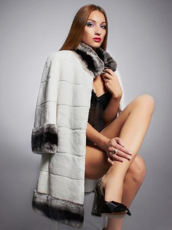 Beautiful young woman lady boss in fur.winter fashion.Beauty sexy Model Girl. Woman in Luxury Fur coat