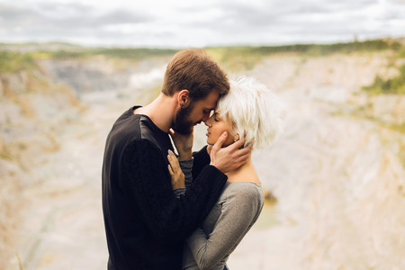 blonds: Lovely couple.romantic beautiful woman and handsome man.bearded boy and blond girl outdoors together Stock Photo