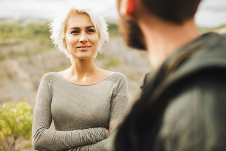 sexy lovers: Young couple.romantic beautiful woman looks at man.boy and girl outdoor together Stock Photo