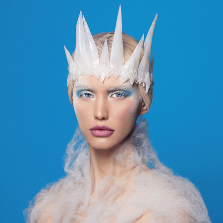 nude blonde woman: halloween snow queen.beautiful blond young woman with make-up Stock Photo