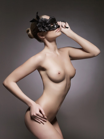 perfect body naked girl in mask.beauty sexy young woman.Sex Party Stock Photo
