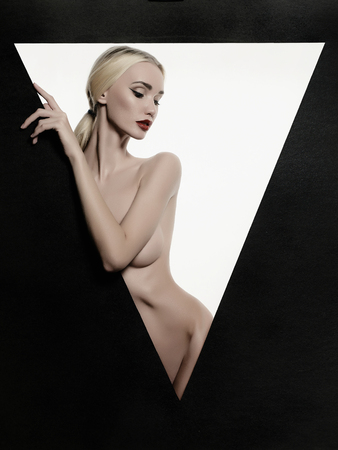 nude: nude beautiful blond young woman.fashion portrait of naked sexy girl in a triangle
