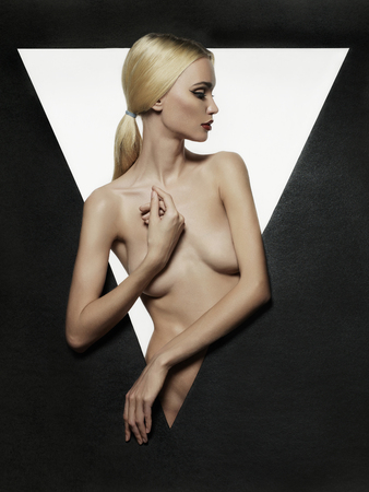 nude adult: nude beautiful blond young woman.fashion portrait of naked sexy girl in a triangle