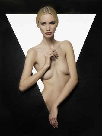 naked girl black hair: naked beautiful blond young woman.fashion portrait of sexy girl in a geometric figure