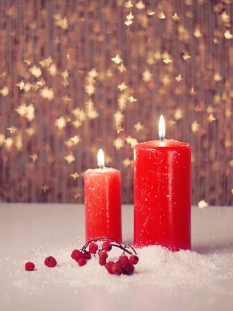 candles: Christmas still life.Happy New Year.Candle and berries on snow Stock Photo