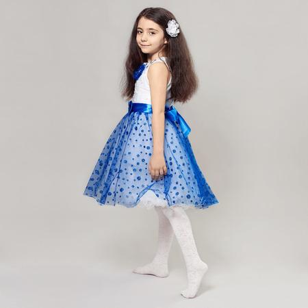 fashion portrait of beautiful little girl with flower in her hair.pretty little princess child Foto de archivo