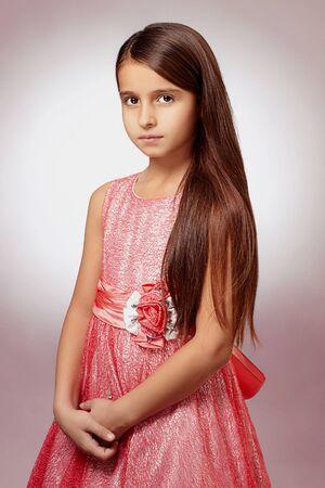 beautiful little girl in dress.pretty little funny child.healthy long hair Stock Photo