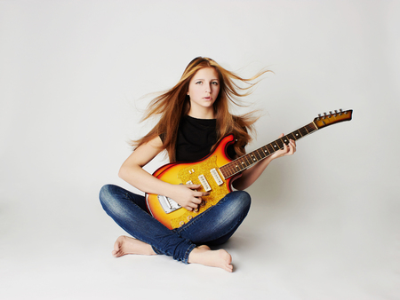 sexy glamour: beautiful young woman with guitar.sexy girl in jeans.rock music Stock Photo