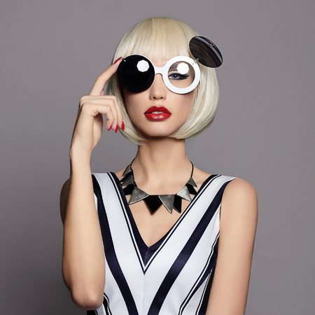 fantastic: future beautiful young woman with make-up. fantastic fashion beauty girl in glasses.black and white
