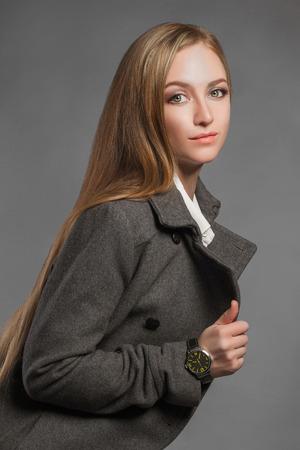 buisiness: fashionable Beautiful Blond Woman in topcoat.trendy Beauty blonde Girl