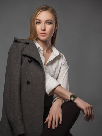 buisiness: fashionable model.Beautiful Blond Woman in topcoat.trendy Beauty blonde Girl Stock Photo