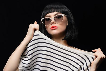 bob: beautiful young woman in sunglasses.retro bob hairstyle beauty girl