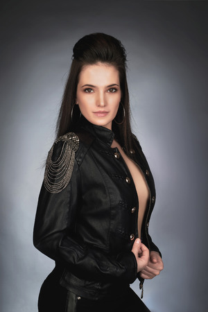 jacked: beautiful young woman in leather coat.rock music girl