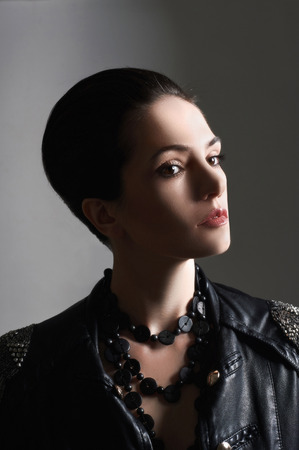 jacked: beautiful young woman in leather coat.boy hairstyle girl Stock Photo