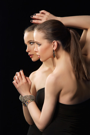 fashion portrait of beautiful woman in jewelry. beauty sexy Girl reflected in the mirror Stock Photo