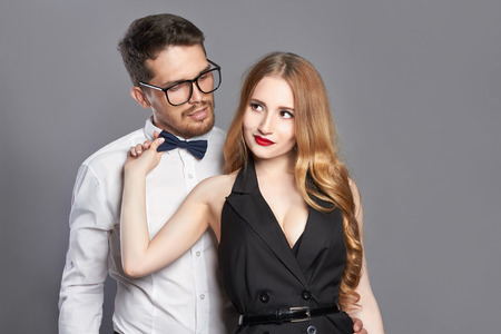 fashionable couple: fashionable couple. Beautiful woman with bearded man in glasses.beauty girl and hipster boy together