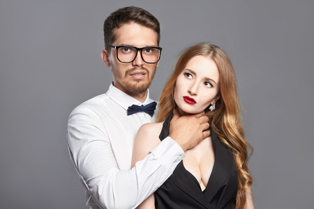 fashionable couple. Beautiful woman with the man in glasses.beauty girl and hipster boy together.strange love Stock Photo