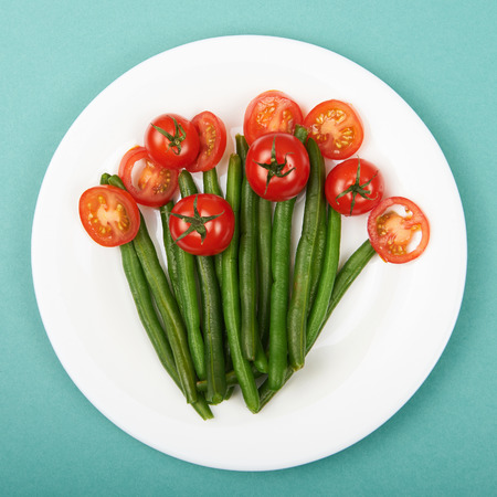 haricot: healthy food still life. vegetarian plate.siliculose haricot and tomatos