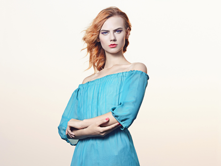 Fashionable Sexy blond girl.Beauitiful young woman in blue dress Stockfoto